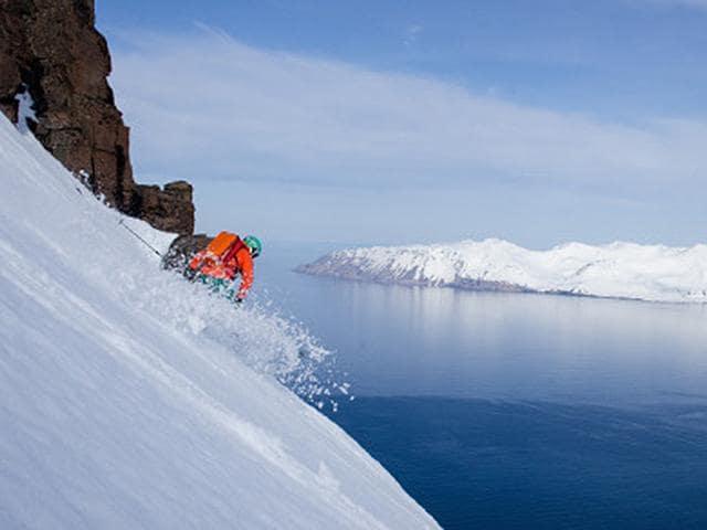 A-Viking-Heliskier-shreds-pow-on-a-steep-drop-with-a-rarefied-view-Photo-AFP