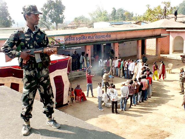 A-security-person-stands-guard-outside-a-polling-station-during-the-first-phase-of-Jharkhand-assembly-election-in-Latehar-PTI-photo