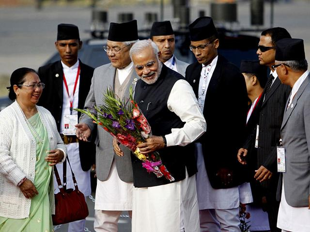 Prime-Minister-Narendra-Modi-receives-a-bouquet-upon-his-arrival-for-the-18th-South-Asian-Association-for-Regional-Cooperation-SAARC-summit-in-Kathmandu-Reuters