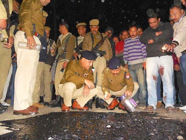 Police-officials-at-a-blast-site-in-Dibrugarh-in-Assam-The-state-is-affected-by-numerous-militant-groups-PTI-photo
