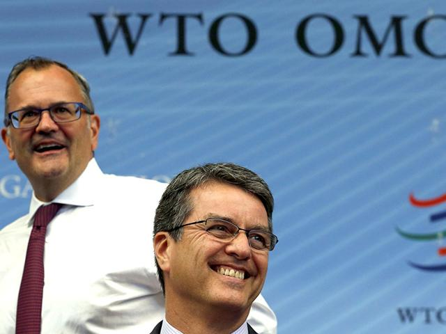 WTO-director-general-Roberto-Azevedo-R-smiles-next-to-spokesperson-Ketih-Rockwell-before-a-special-meeting-of-the-General-Council-Preparatory-Committee-on-Trade-Facilitation-at-the-WTO-headquarters-in-Geneva-Reuters-Photo