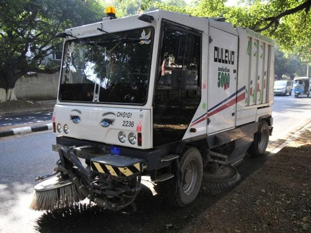 A-sweeping-machine-which-has-become-more-of-a-showpiece-for-the-civic-body-is-seen-cleaning-the-road-dividing-Sector-20-and-21-in-Chandigarh-on-Thursday--HT-Photo