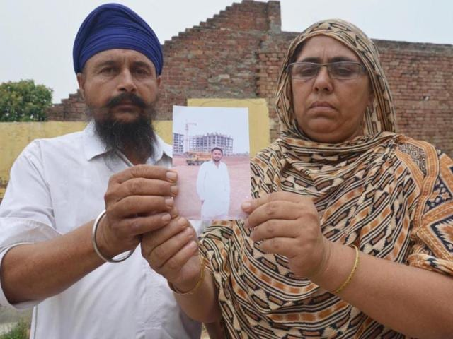 Sialka-villagers-Ranjit-Kaur-right-and-Balkar-Singh-are-praying-for-their-son-Jatinder-Singh-HT-Photo