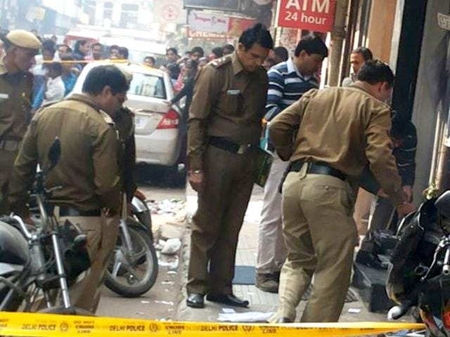 Police-inspect-the-scene-of-crime-after-miscreants-looted--a-cash-van-outside-Citi-Bank-s-ATM-in-Kamla-Nagar-area-Photo-courtesy-ANI-news