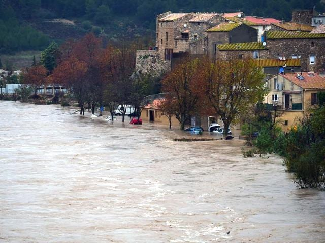 A-photo-shows-the-swollen-river-La-Berre-in-the-flooded-city-of-Portel-des-Corbieres-southern-France-AFP-Photo