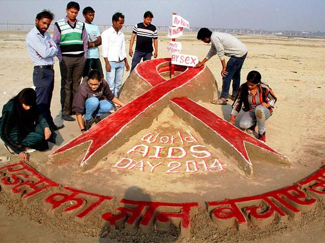 Students-of-Allahabad-University-create-sand-art-to-raise-awareness-on-AIDS-on-the-eve-of-World-AIDS-day-on-the-banks-of-the-Ganga-river-in-Allahabad-on-Sunday-PTI-Photo