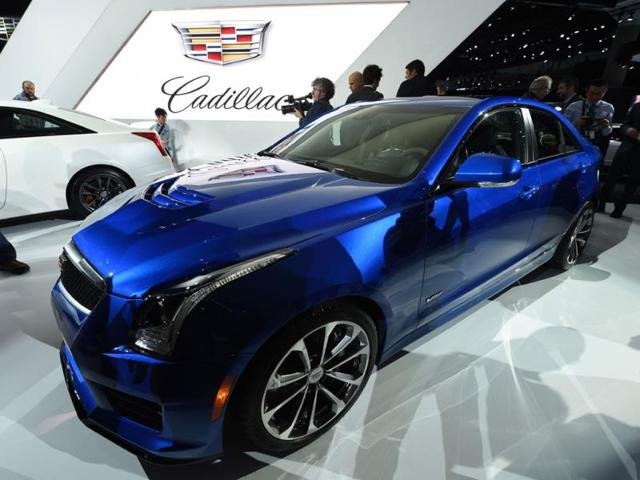 The-Cadillac-2016-ATS-V-coupe-and-sedan-make-their-world-debut-at-the-LA-Auto-Show-Photo-AFP