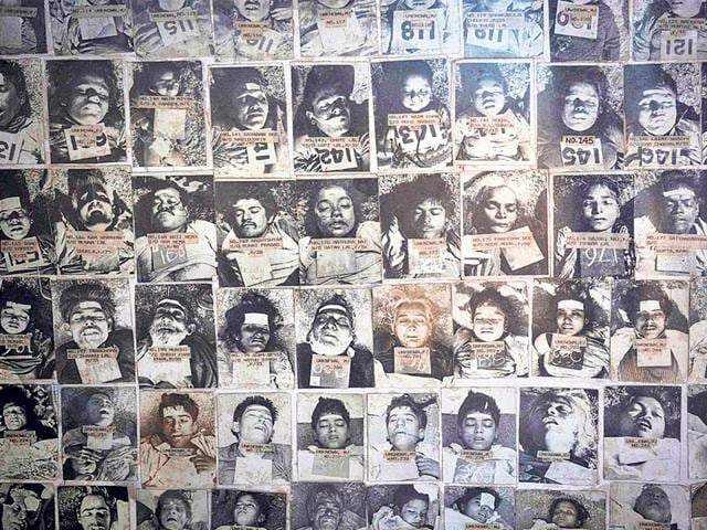 A-panel-at-the-forensic-department-of-a-Bhopal-hospital-displays-pictures-of-residents-who-died-in-the-gas-leak-disaster-Reuters-photo