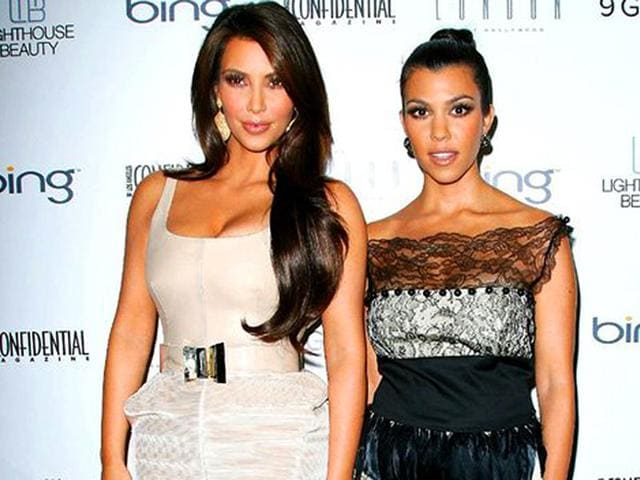 Reality-TV-star-Kourtney-Kardashian-with-younger-sister-Kim-at-an-event-AFP