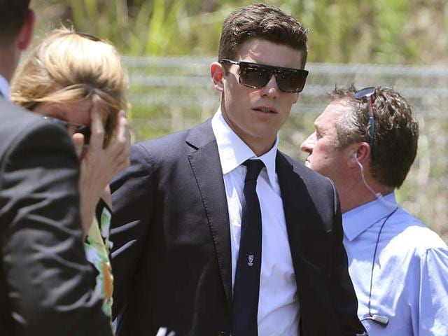 Australian-bowler-Sean-Abbott-R-arrives-for-Hughes-funeral-on-Wednesday-The-funeral-for-Hughes-turned-into-a-celebration-of-his-life-despite-the-grief-and-sorrow-still-evident-from-his-death-AFP-Photo