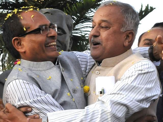 CM Shivraj Singh Chouhan and MP BJP president Nandkumar Singh Chauhan celebrate the party's victory in civic polls, in Bhopal. (Mujeeb Faruqui/HT photo)