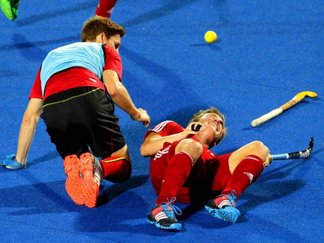 Germany-red-jersey-and-Belgium-yellow-jersey-hockey-players-in-action-during-the-practice-match-of-Hero-Men-s-Champions-Trophy-2014-in-Bhubaneswar-Virendra-Singh-Gosain-HT-Photo