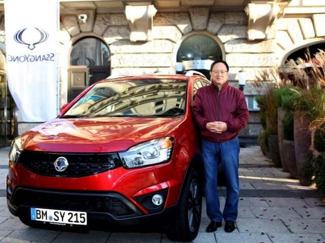 Lee-Yoo-il-CEO-of-Ssangyong-Motors-the-South-Korean-subsidiary-of-India-s-Mahindra-poses-with-Tivoli-which-will-be-launched-in-January-HT-Photo