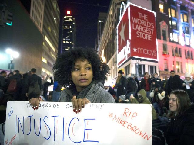 Protestor-Rayyan-Ali-cries-as-she-protests-in-Herald-Square-in-New-York-in-response-to-a-grand-jury-s-decision-not-to-indict-the-police-officer-involved-in-the-death-of-Eric-Garner-AP-Photo