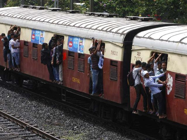 Passengers-travel-on-the-footboards-of-a-suburban-local-train-in-Mumbai-Kunal-Patil-HT-file-photo