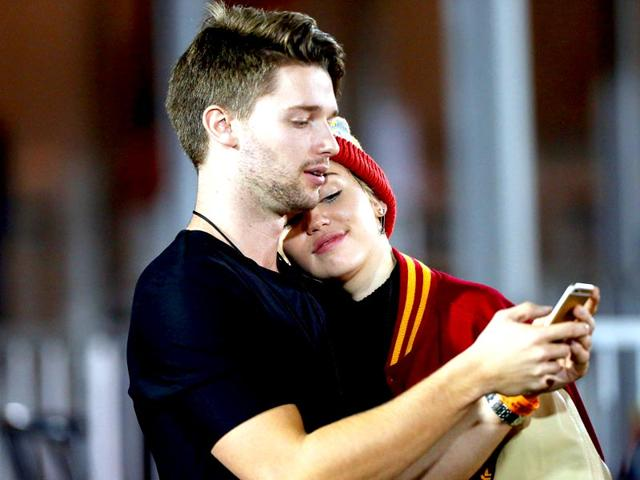 Singer-Miley-Cyrus-and-her-new-boyfriend-Patrick-Schwarzenegger-AFP