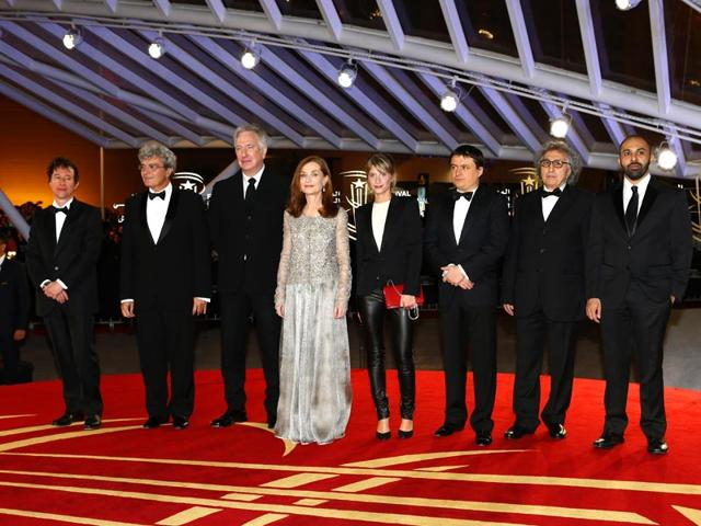 Jury-members-from-left-to-right-Bertrand-Bonello-Mario-Martone-Alan-Rickman-Isabelle-Huppert-Melanie-Laurent-Cristian-Mungiu-Moumen-Smihi-and-Ritesh-Batra-attend-the-photocall-during-the-14th-Marrakech-International-Film-Festival-Friday-December-5-2014-The-film-festival-takes-place-until-Dec-13-AP