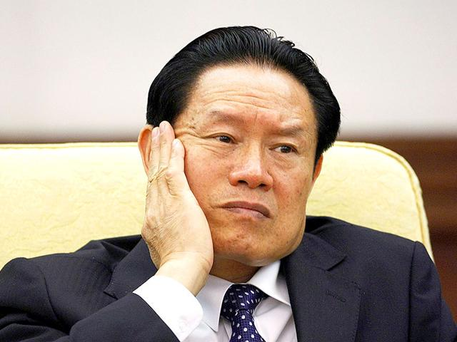 Zhou-Yongkang-reacts-as-he-attends-the-Hebei-delegation-discussion-sessions-at-the-17th-National-Congress-of-the-Communist-Party-of-China-at-the-Great-Hall-of-the-People-in-Beijing-in-this-October-16-2007-file-photo-Reuters