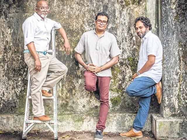 From-left-Bose-Krishnamachari-Jitish-Kallat-and-Riyas-Komu-take-a-break-while-preparing-for-the-biennale-in-Kochi-Mumbai-based-artist-Sahej-Rahal-works-on-his-art-pieces-ahead-of-the-event-Photo-by-courtesy-kochi-biennale-foundation