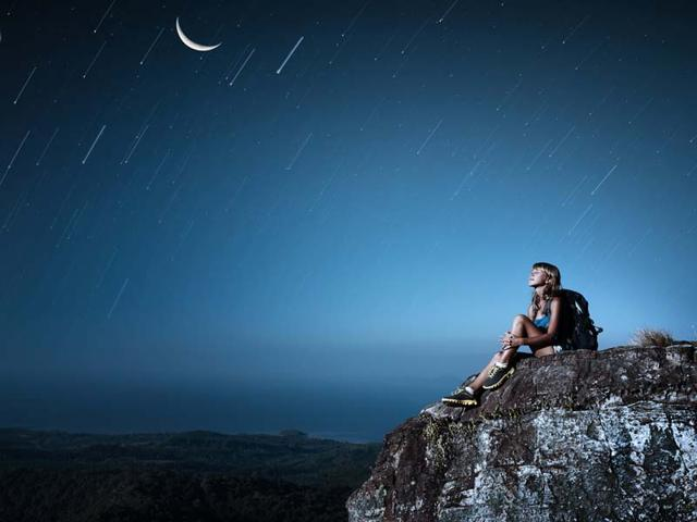Woman-looking-at-stars-Shutterstock-image