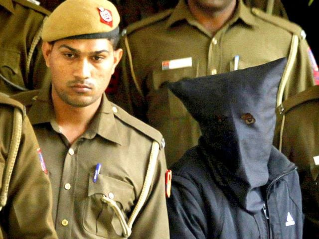 Police-escort-Uber-taxi-driver-and-accused-rapist-Shiv-Kumar-Yadav-following-his-court-appearance-in-New-Delhi-HT-photo