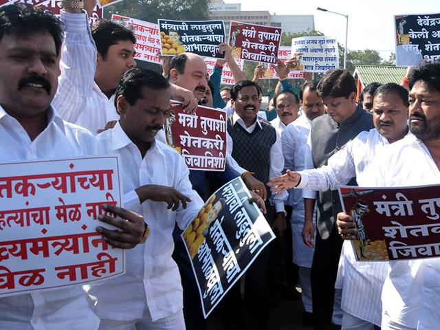 NCP-leader-Ajit-Pawar-and-party-MLAs-shout-slogans-against-farmers-suicide-and-drought-problems-on-the-second-day-of-the-winter-session-in-Nagpur-Maharashtra-Sunny-Shende-HT-photo