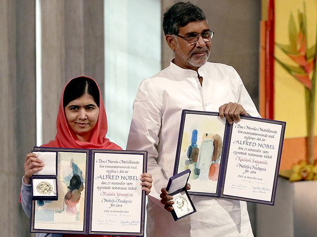 Kailash-Satyarthi-and-Malala-Yousafzai-pose-with-their-medals-during-the-Nobel-Peace-Prize-awards-ceremony-at-the-City-Hall-in-Oslo-Norway-AFP-Photo