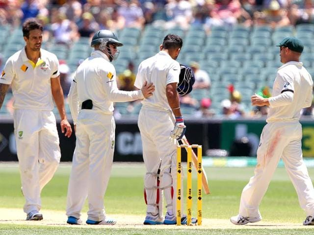 Virat-Kohli-is-checked-by-Australia-s-Mitchell-Johnson-left-Steve-Smith-and-David-Warner-right-after-Kohli-was-hit-in-the-head-with-a-bouncer-from-Johnson-during-the-third-day-of-their-cricket-Test-match-in-Adelaide-Australia-AP-Photo