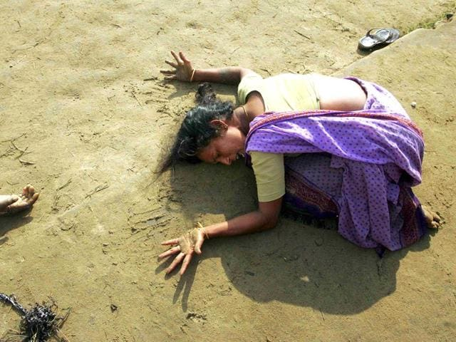 An Indian woman mourns the death of her relative who was killed in the tsunami in Cuddalore, south of Madras, in December 2004. (Reuters)