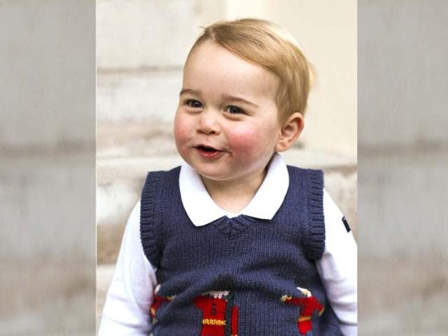 In-this-photo-provided-by-The-Duke-and-Duchess-of-Cambridge-and-taken-in-late-November-2014-Britain-s-Prince-George-poses-in-a-courtyard-at-Kensington-Palace-London--AP-Photo