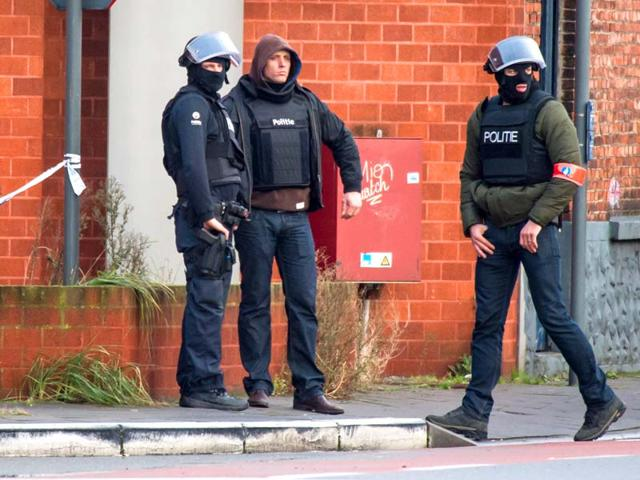 Special-forces-police-guard-a-street-in-Ghent-western-Belgium-Four-armed-men-have-entered-an-apartment-and-police-have-blocked-off-a-wide-perimeter-around-the-area-AP-Photo