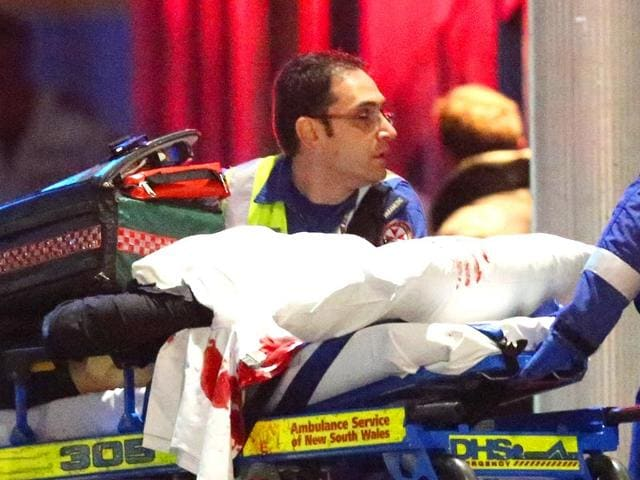 A-deceased-hostage-is-carried-out-of-a-cafe-in-the-central-business-district-of-Sydney-AFP