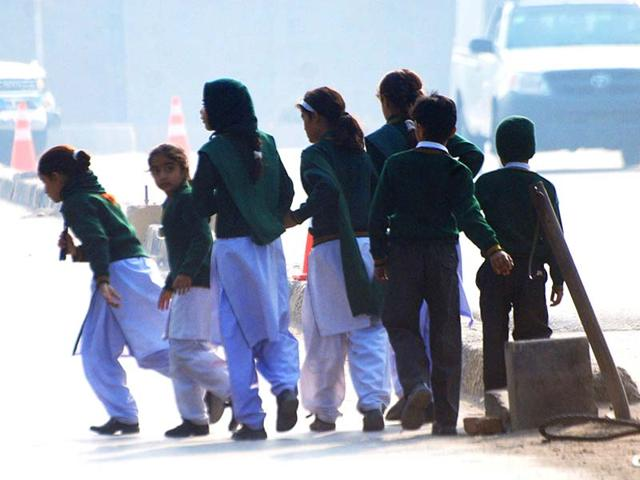 Schoolchildren-cross-a-road-as-they-move-away-from-a-Pakistan-army-run-school-that-was-under-attack-from-Taliban-gunmen-in-Peshawar-Reuters-Photo