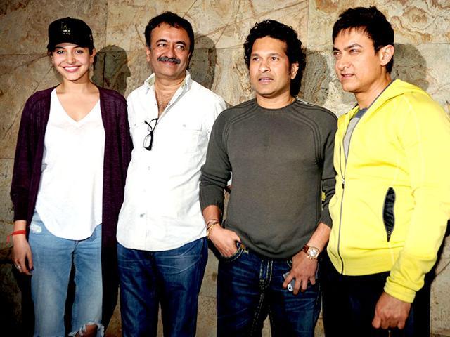 Anushka-Sharma-Rajkumar-Hirani-and-Aamir-Khan-pose-for-a-photograph-with-Sachin-Tendulkar-during-a-promotional-event-for-PK-in-Mumbai-on-December-16-2014-AFP-Photo