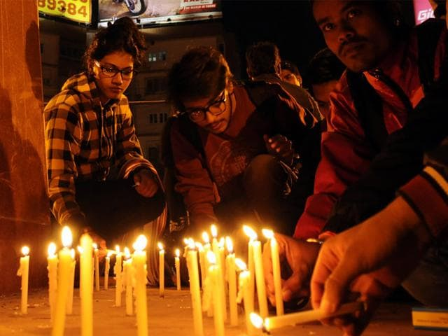 People lit candles in Indore to show solidarity with the victims of Peshawar school attack. (Amit K Jaiswal/HT photo)
