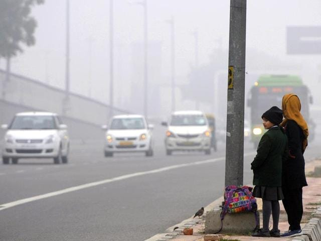 A-school-student-waits-during-a-cold-and-foggy-morning-at-Mayur-Vihar-in-New-Delhi-Sushil-Kumar-HT-Photo