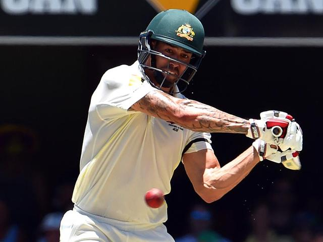 Mitchell-Johnson-plays-a-shot-on-the-third-day-of-the-2nd-Test-match-between-Australia-and-India-at-The-Gabba-in-Brisbane-AFP-Photo
