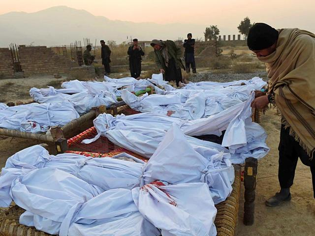 A-Pakistani-Frontier-Corps-member-looks-at-gathered-bodies-of-militants-who-were-killed-in-a-military-operation-in-Tirah-near-the-Pakistan-Afghanistan-border-AFP-PHOTO