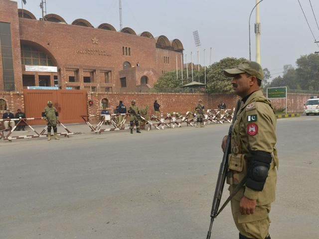 A-plainclothes-security-officer-escorts-students-evacuated-from-a-nearby-school-after-the-Taliban-attack-on-Army-Public-School-in-Peshawar-Pakistan-AP-Photo