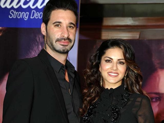 Sunny Leone and husband Daniel Weber during an event in Mumbai on Saturday. (AFP)