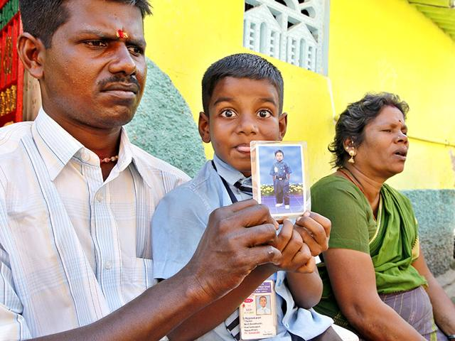 T-Shankar-left-and-Chintamani-sit-with-their-son-Rajshekara-holding-a-photo-of-their-deceased-son-Paneersilvam-during-an-interview-with-HT-in-Nagapattinam-Tamil-Nadu-HT-Photo-Gurinder-Osan