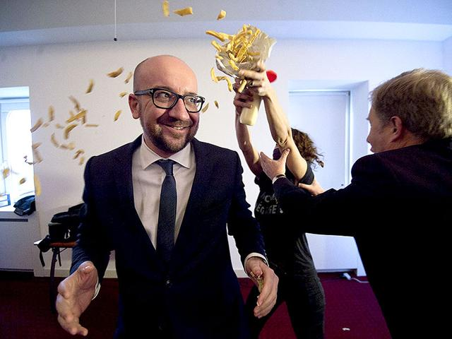 Pierre-Rion-right-tries-to-intervene-as-activists-throw-fries-and-mayonnaise-on-Belgian-Prime-Minister-Charles-Michel-at-a-conference-at-the-Cercle-de-Wallonie-in-Namur-on-Monday-AFP-Photo