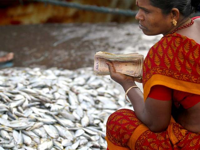 A-fisherwomen-sells-her-catch-at-a-fish-market-in-Nagapattinam-s-harbour-in-Tamil-Nadu-HT-Photo-Gurinder-Osan