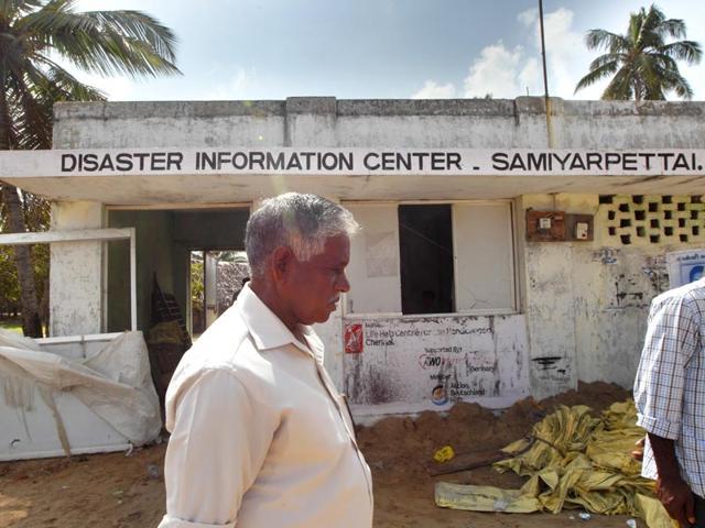 A-resident-walks-past-a-neglected-Disaster-Information-Center-in-Samiyarpettai-along-the-Tamil-Nadu-coast-HT-Photo-Gurinder-Osan