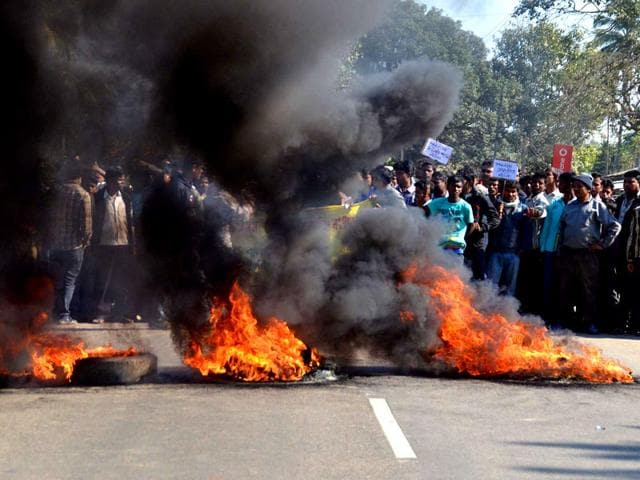 Activists-of-the-Assam-Tea-Tribes-Student-Association-ATTSA-block-the-NH-52-road-with-burning-tyres-during-a-protest-against-the-attacks-on-villagers-in-Assam-AFP-Photo