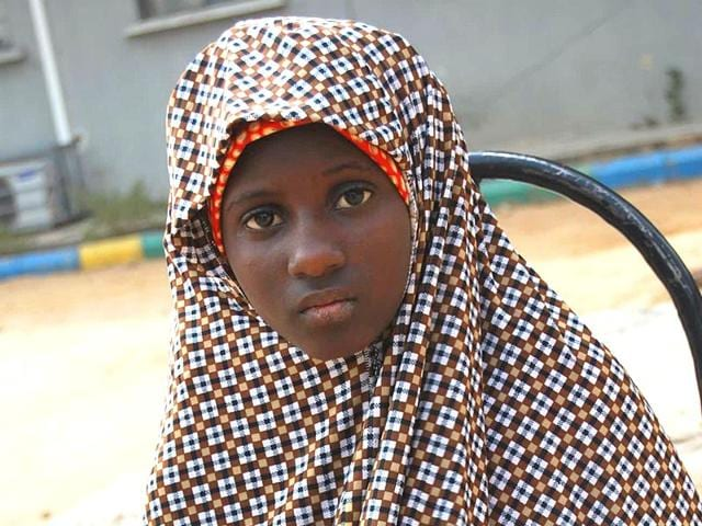 In-this-photo-taken-Wednesday-Dec-24-2014-Zahra-u-Babangida-a-13-year-old-girl-arrested-with-explosives-strapped-to-her-body-in-Kano-AFP
