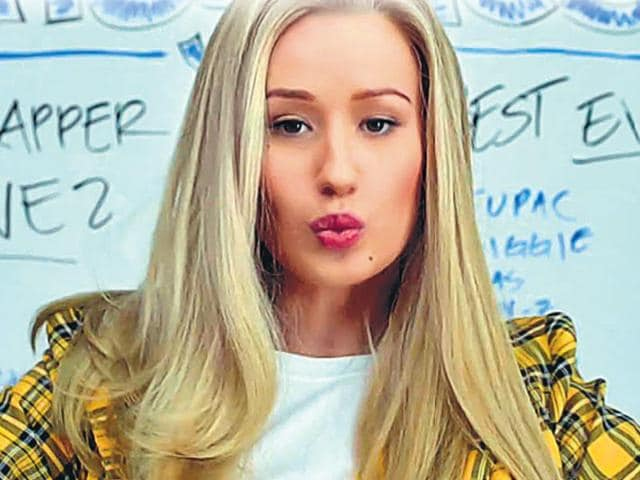 Iggy-Azalea-in-Fancy-Clueless-chic-Remember-the-iconic-1995-movie-Clueless-Iggy-s-look-in-the-video-seems-like-an-update-on-the-rich-kid-high-school-style-from-the-film-We-love-the-clean-makeup-and-the-enviable-long-locks-that-spell-all-business