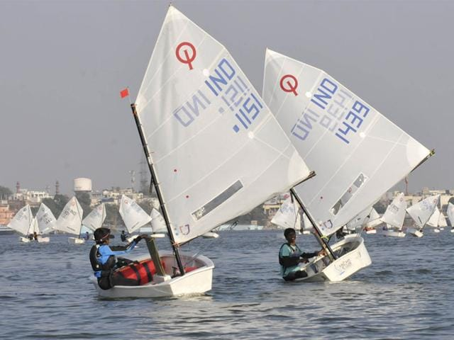 Sailors compete in the National Inland Optimist Sailing Championship 2014, in Bhopal on Saturday. Nearly 50 teams from all over India are taking part in the event. (Mujeeb Faruqui/HT photo)