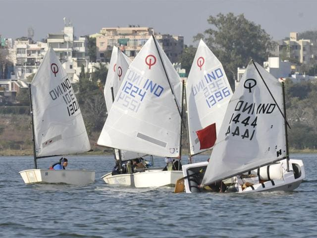 Sailors compete in the National Inland Optimist Sailing Championship 2014, in Bhopal on Saturday. The event will be held till December 30. (Mujeeb Faruqui/HT photo)