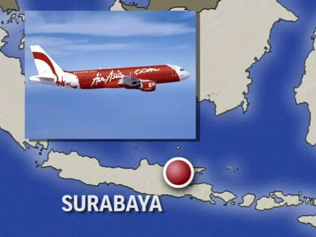 Part-of-the-tail-of-AirAsia-QZ8501-floats-on-the-surface-after-being-lifted-as-Indonesian-navy-divers-conduct-search-operations-for-the-black-box-flight-recorders-and-passengers-and-crew-of-the-aircraft-in-the-Java-sea-Reuters